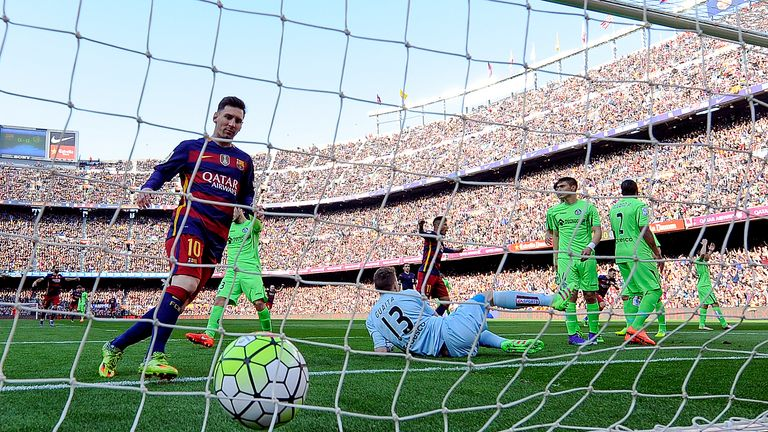 Messi collects the ball from the Getafe net after another Barcelona goal