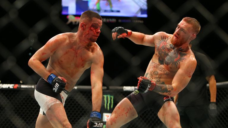 Nate Diaz punches Conor McGregor during UFC 196 at the MGM Grand in Las Vegas