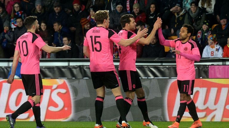 Ikechi Anya (right) celebrates putting Scotland ahead
