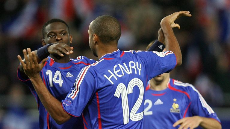 Louis Saha (No 14) and Thierry Henry celebrate a goal for France