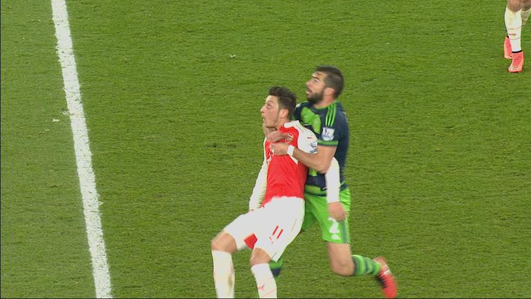 Ozil and Amat: Should the referee have blown for a foul?