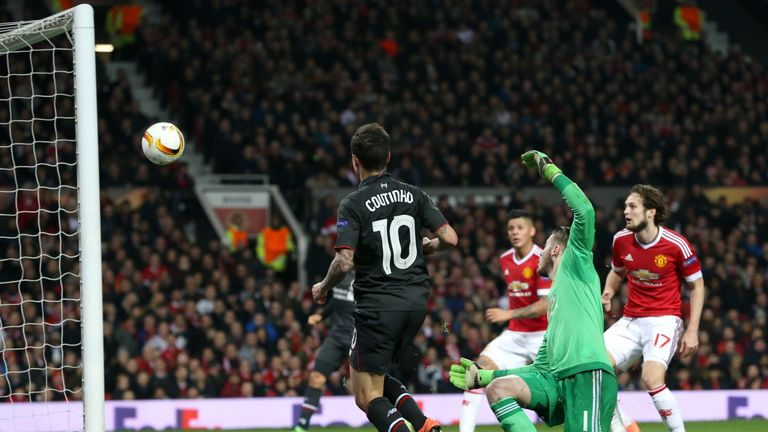 Coutinho scores his side's first goal of the game during the  match at Old Trafford