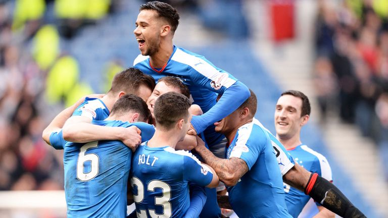 Rangers players celebrate their third goal against Dundee