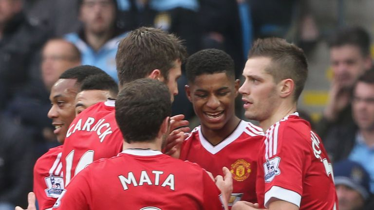 Rashford celebrates with team-mates his 16th-minute goal put Manchester United 1-0 up against their City rivals