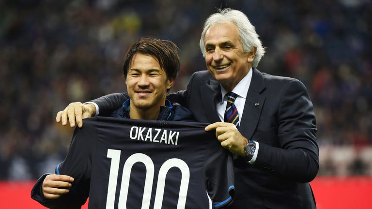 Okazaki poses for photographs with a shirt to mark his 100th appearance for Japan