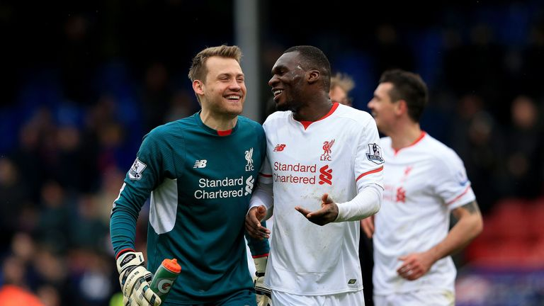 Liverpool goalkeeper Simon Mignolet and Christian Benteke celebrate