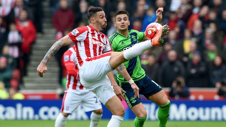 Geoff Cameron and Tadic compete for the ball in the first half