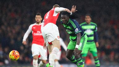 Swansea's Bafetimbi Gomis (right) in action against Arsenal