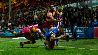 Leeds Rhinos v Huddersfield Giants - Huddersfield's Jermaine McGillvary can't prevent Leeds's Joel Moon from scoring a try.