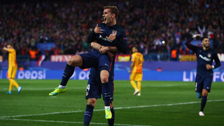 Antoine Griezmann scored once in each half to send Atletico Madrid into the Champions League semi-finals