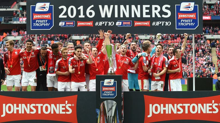 Barnsley players celebrate after winning the Johnstone's Paint Trophy last season