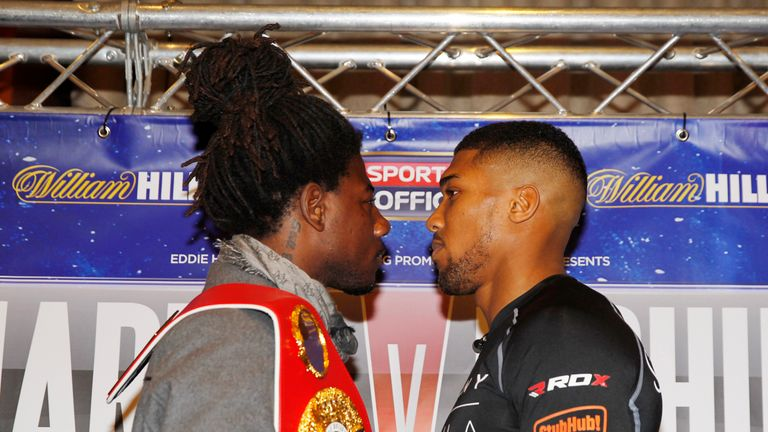 Martin (left) defends his world title against Joshua at The O2