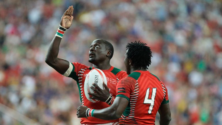Collins Injera (L) celebrates with Augustine Lugonzo after scoring a try during Kenya's Singapore Sevens final win over Fiji