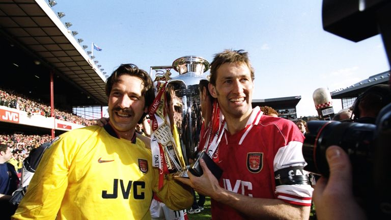 Arsenal club captain Tony Adams holds the Premier League trophy with David Seaman after scoring in the 4-0 win against Everton