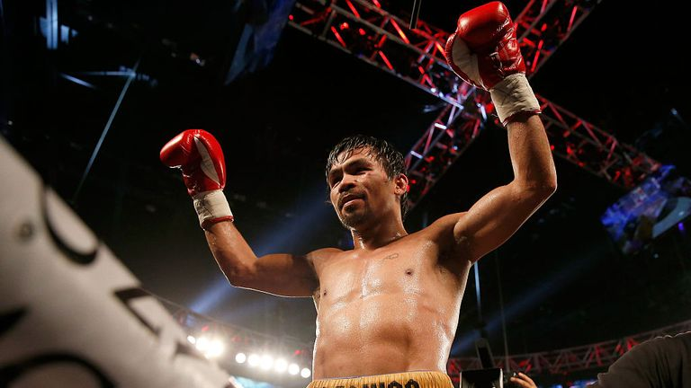 Manny Pacquiao celebrates victory for what could be the last time