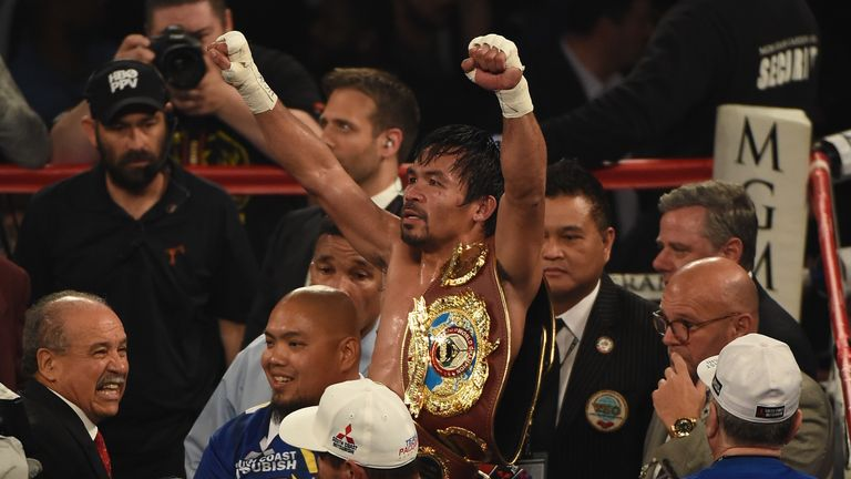 Manny Pacquiao celebrates after defeating Timothy Bradley