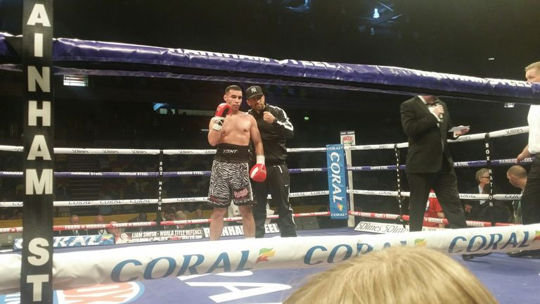 Tony Bange with his trainer after victory at Copper Box