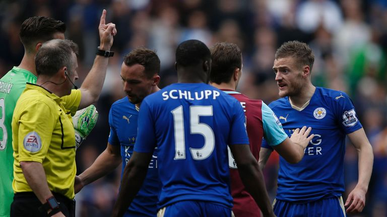 Leicester Jamie Vardy (right) reacts after referee Jonathan Moss awarded him a second yellow card for simulation