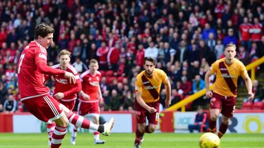Aberdeen's Kenny McLean (left) converts a penalty to give his side the lead against Motherwell