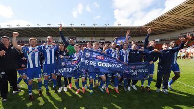 Wigan players and staff celebrate winning promotion (pic courtesy of Peter Powell)
