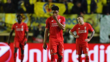 Liverpool players look dejected after Villarreal's late winner