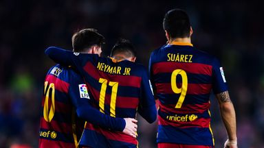 Neymar is congratulated by his teammates Luis Suarez and Lionel Messi after scoring