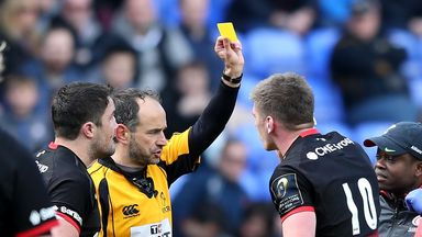 Owen Farrell is yellow-carded by referee Romain Poite during Saracens' win over Wasps