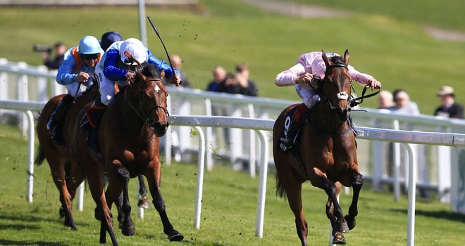 Do Mi Dar (right), ridden by Frankie Dettori, comes home to win the Investec Derby Trial