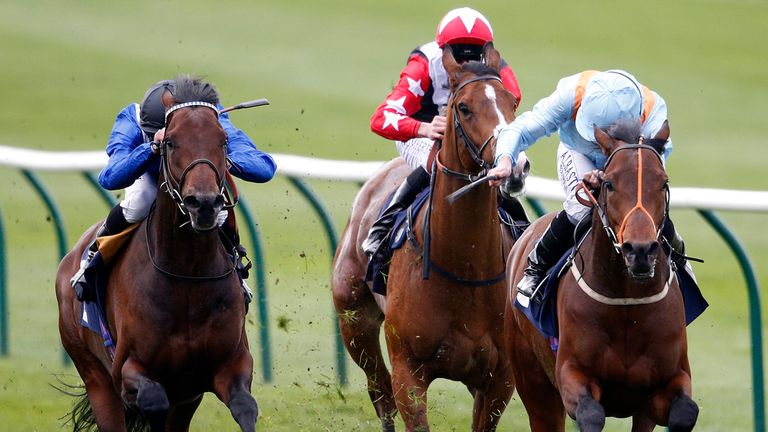 NEWMARKET, ENGLAND - APRIL 12: Ryan Moore riding Ventura Storm (R) win The 1stsecuritysolutions.co.uk Feilden Stakes at Newmarket racecourse on April 12, 2