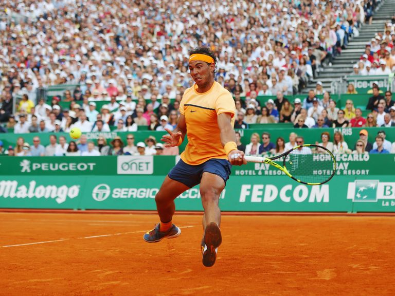 Rafael Nadal plays a forehand during the singles final match against Gael Monfils