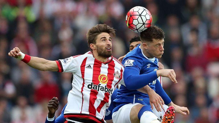 Fabio Borini (left) challenges with Everton's Ross Barkley
