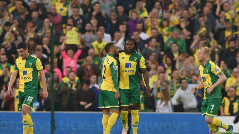 Dieumerci Mbokani celebrates his brace against Watford at a downbeat Carrow Road