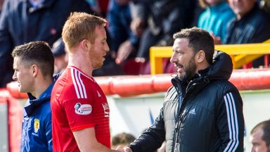 Aberdeen striker Adam Rooney  (left) is congratulated by Derek McInnes as he leaves the pitch during the game against Motherwell