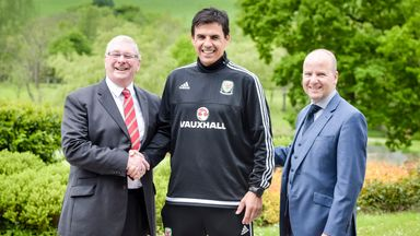 Coleman shakes hands with Football Association Wales president David Griffiths (left) and FAW chief executive Jonathan Ford after Monday's announcement