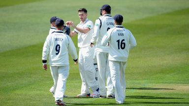 Chris Woakes took a remarkable 9-36 for Warwickshire against Durham
