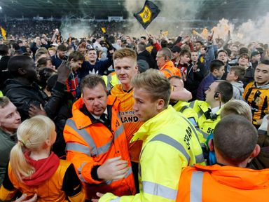 Sam Clucas gets escorted off the pitch after Hull reach the  play-off final