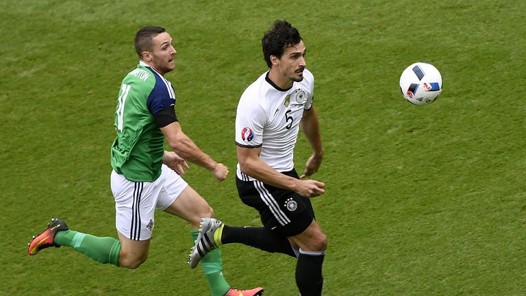 Mats Hummels (right) battles for the ball with Conor Washington at Euro 2016