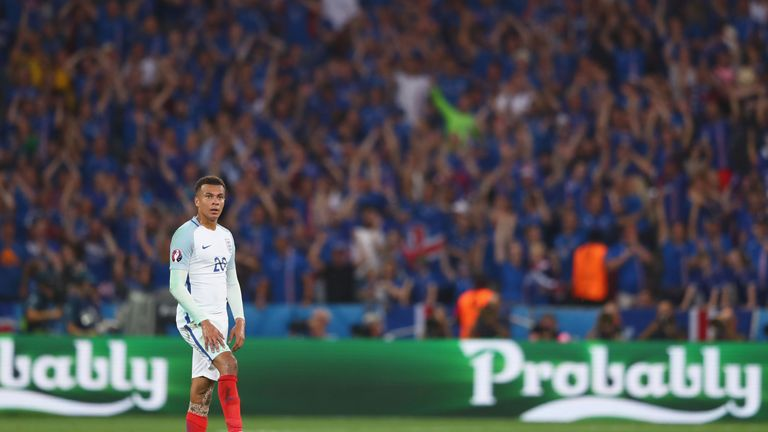 Dele Alli looks on following Iceland's second goal