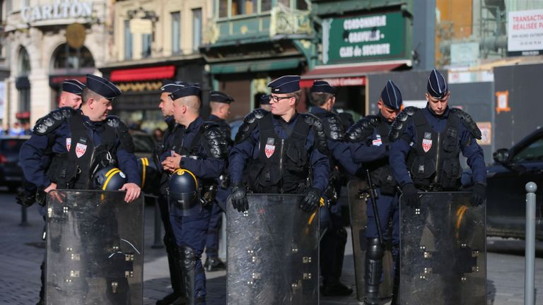 Riot police outside the train station in Lille city centre