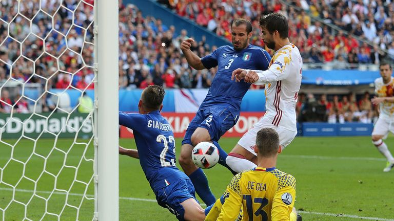 Giorgio Chiellini pounces to open the scoring for Italy against Spain