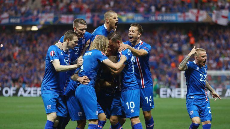 Ragnar Sigurdsson (centre, obscured) celebrates Iceland's second goal against England