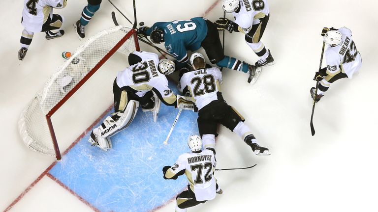 The Penguins combine to stop Justin Braun of the San Jose Sharks