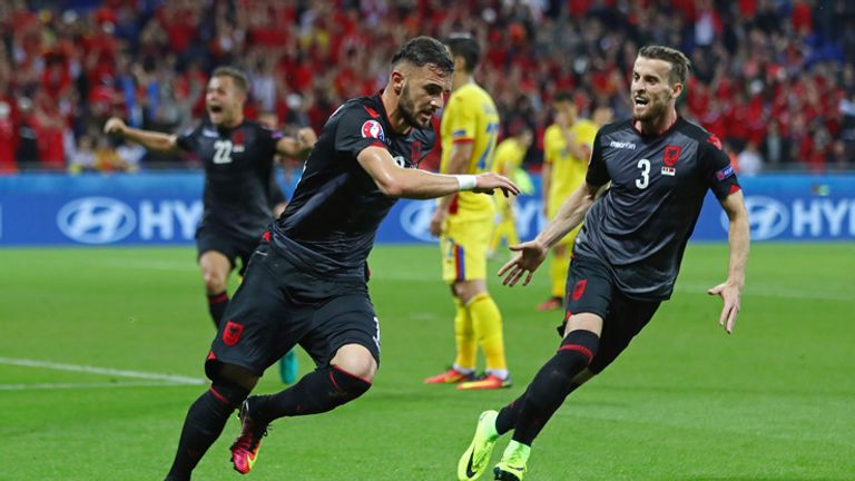 Armando Sadiku celebrates scoring the winning goal for Albania against Romania