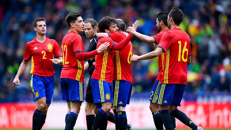 David Silva (middle) celebrates after scoring the opening goal