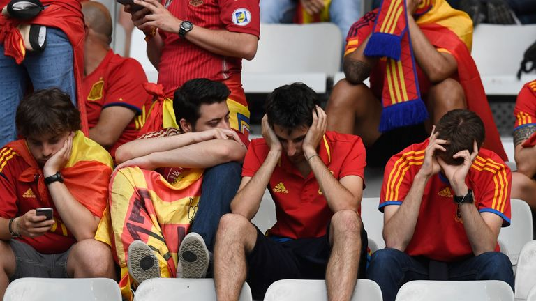 Dejected Spain supporters remain in their seats after seeing their side ousted from Euro 2016 by Italy