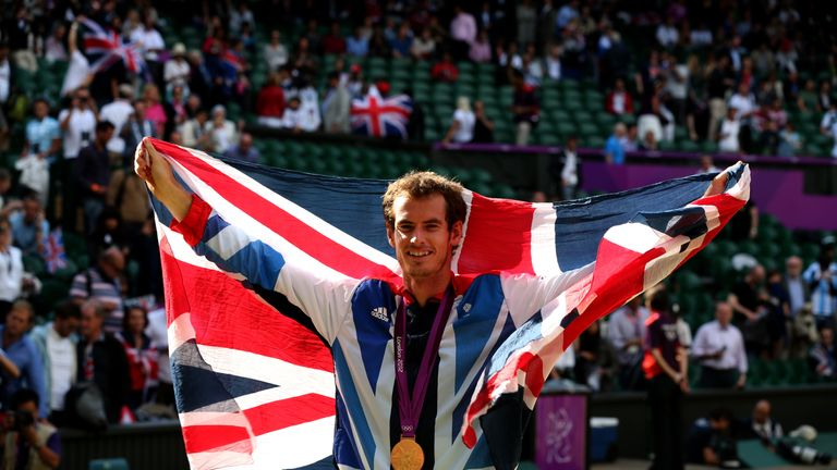 Gold medalist Andy Murray celebrates during the medal ceremony at the 2012 Olympic Games in London