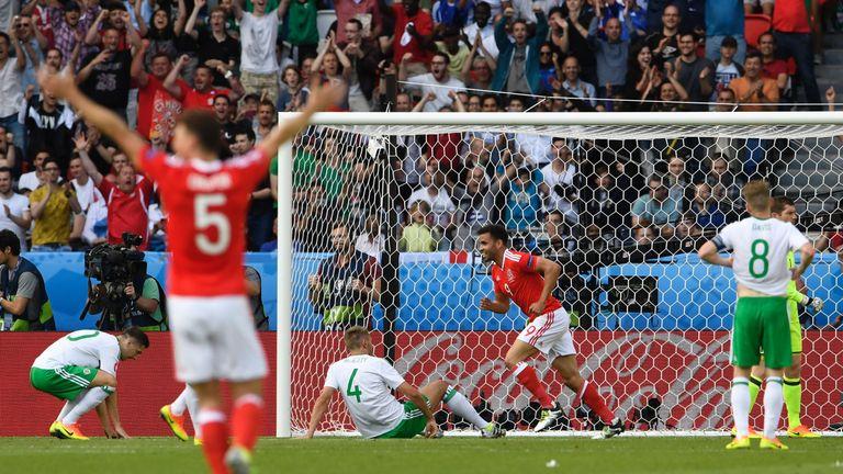 Wales celebrate Gareth McAuley's own goal