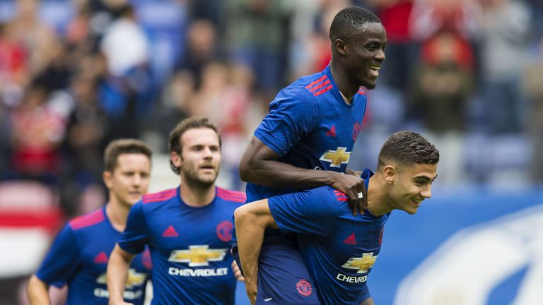 Andreas Pereira (right) celebrates his goal with Eric Bailly