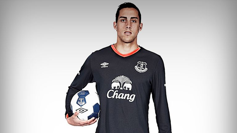 Everton's 2016/17 away kit - navy with a salmon trim - is modelled by Ramiro Funes Mori