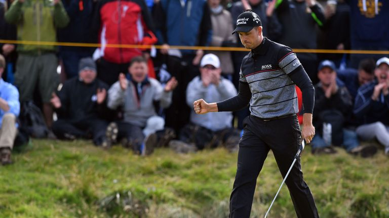 Henrik Stenson celebrates a birdie at the 14th to spark a run of four over the last five holes